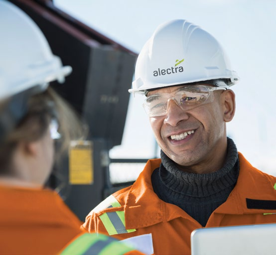 Alectra worker smiling and speaking to another worker