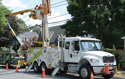 Workers in an Alectra Utility Truck fixing power lines