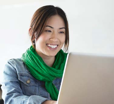 woman smiling while on the computer