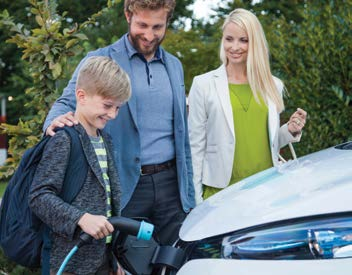 a family plugging in their electric vehicle