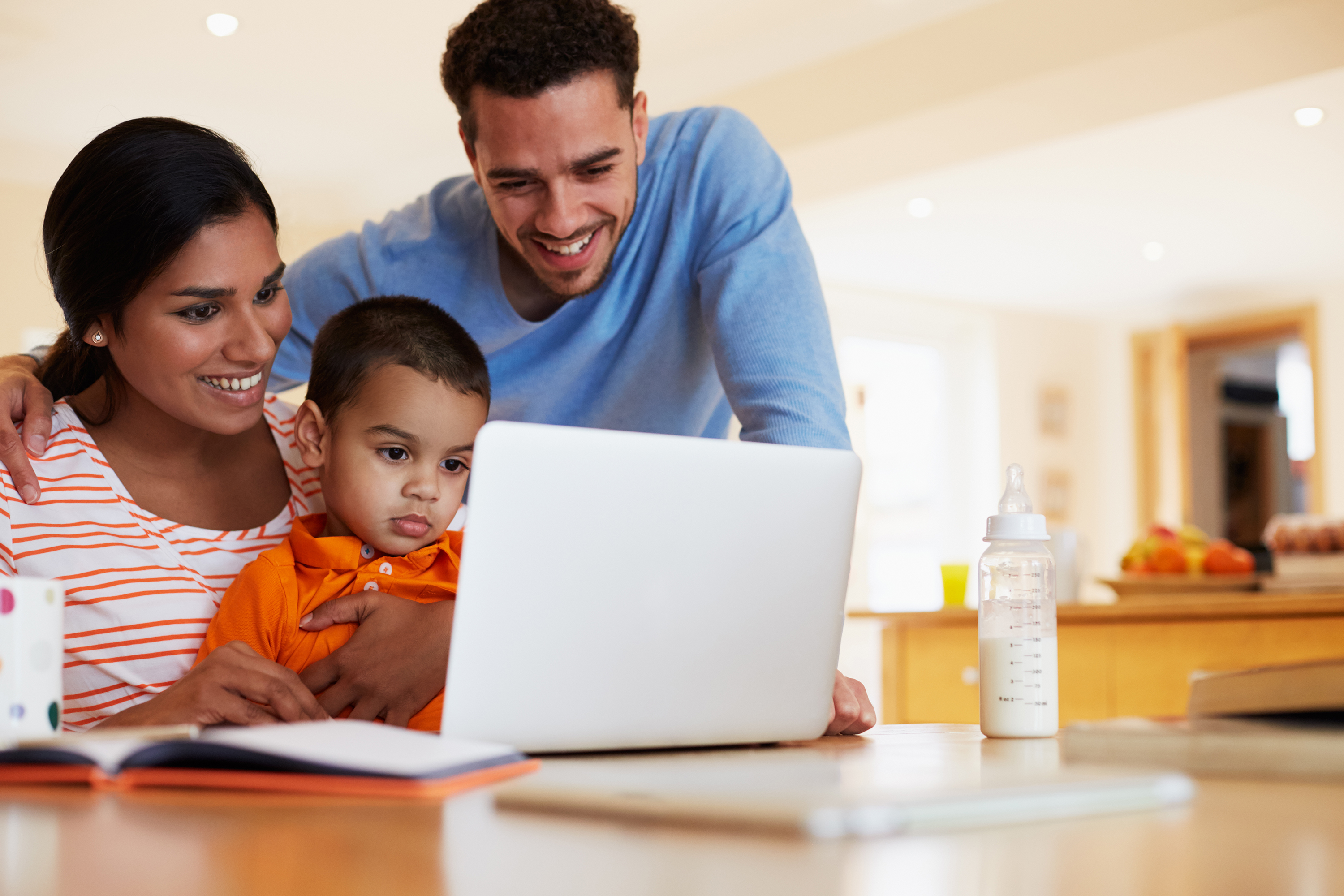 smiling family looking at a computer